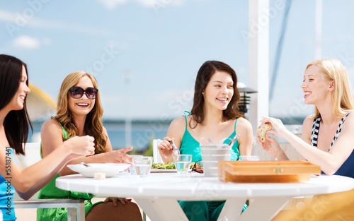 Girls In Cafe On The Beach Stock Photo And Royalty Free