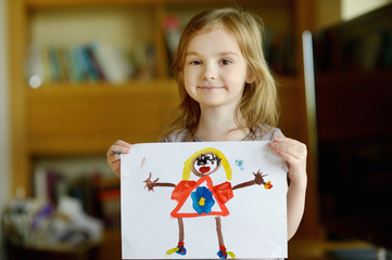 Little preschooler girl displaying her picture