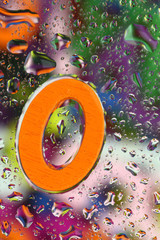 Number zero on abstract colorful drops background