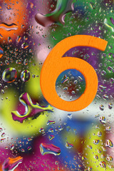 Number six on abstract colorful drops background