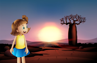 A small girl at the desert wearing a blue skirt