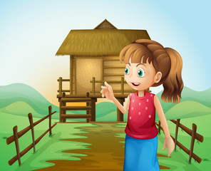 A woman in front of the nipa hut in the farm