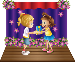 A girl giving gifts to her friend