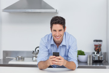 Man typing on his smartphone