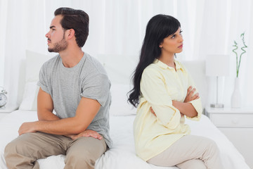 Couple sulking with arms crossed