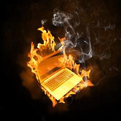 Laptop in fire flames