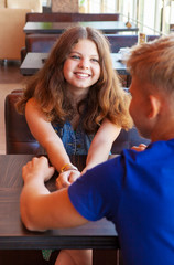 Young teenage couple sitting in cafe