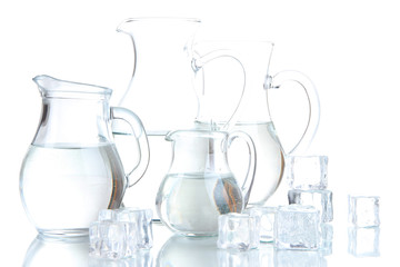 Glass pitchers of water isolated on white