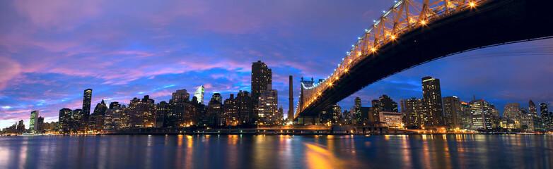 NYC Queensboro Bridge and Manhattan skyline panorama at dusk
