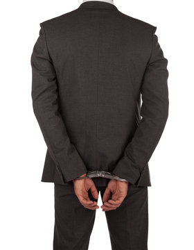Businessman in suit and handcuffs