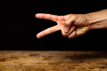 Hand making scissor gesture