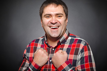 Portrait of a young successful man laughing