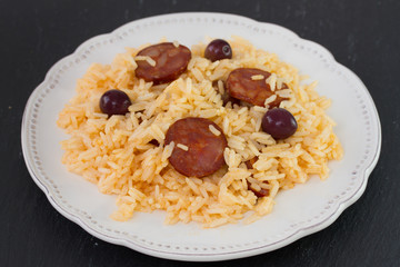 sausages with rice on the white plate