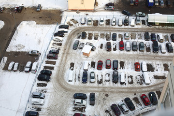 parking lot with many cars in winter