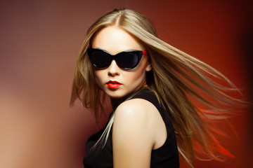 Fashion woman in sunglasses, studio shot. Professional makeup