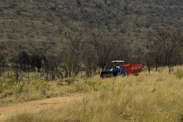 Black farmer in a tractor working in the fields in South Africa
