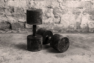 Two old and rusty dumbbells