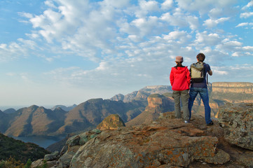 Couple looking at Blyde river canyon, travel in South Africa Wall mural