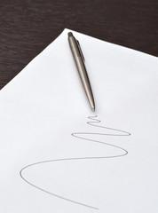 pen lying on a sheet of paper