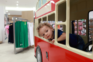 Child in little bus