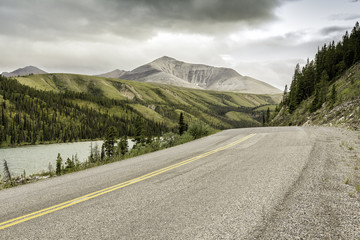 Asphalt road in high mountains of Canada