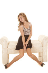 Woman business sit bench legs out