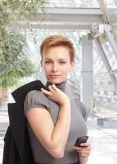 Outdoor portrait of attractive businesswoman