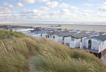 View at houses on beach with sea in IJmuiden, The Netherlands