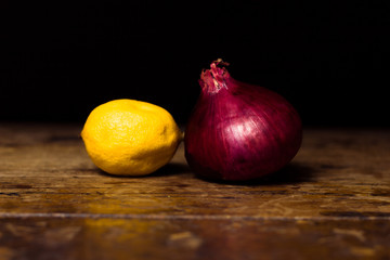 lemon and onion on wooden surface