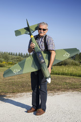 Friendly senior RC modeller showing his new plane model
