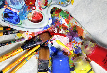 Art palette, tubes with paints and paintbrushes
