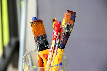 Mix of paintbrushes stained with paints