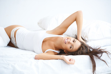Beautiful woman having a lazy day in bed