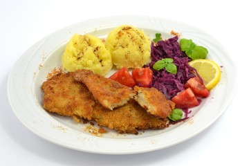pollock fried with potatoes and vegetables