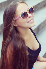 young woman with very long hair. fashion photo shoot