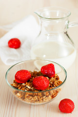 Granola with milk and strawberries