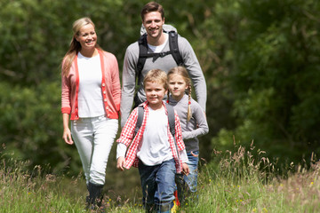 Family Hiking In Countryside Wall mural