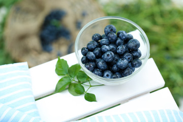 Blueberries in glass plate near napkin