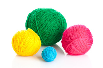 colorful different thread balls.   wool knitting on white backgr