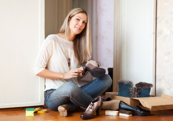 Woman cleans shoes