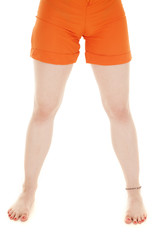 Woman legs orange shorts barefoot