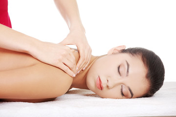 Preaty young woman relaxing heaving massage therapy