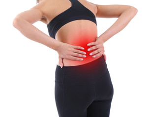 Lower back pain in woman isolated on white