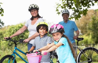 Grandparents And Grandchildren On Cycle Ride In Countryside