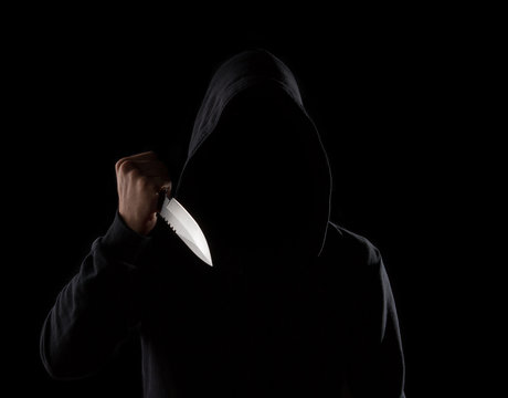 Dangerous hooded man holding knife