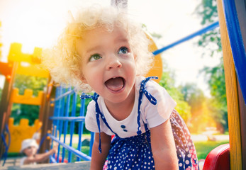 funny  little girl at playground