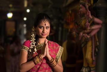 Indian girl praying