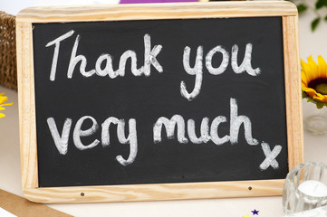 thank you very much message written in chalk on a small blackboa
