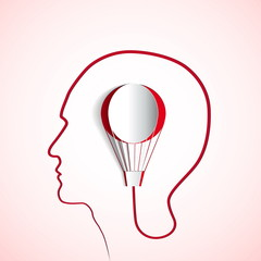 Human head with red paper air balloon - symbol Freedom and creat