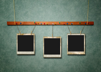 Photo Frames on green textured background.